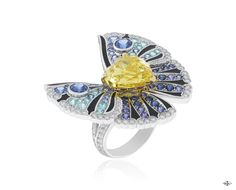 Les Ateliers Creations by Van Cleef & Arpels -Trésor Ailé ring, Palais de la chance collection- White gold, diamonds, blue and purple sapphires, black lacquer, yellow gold, one heart-shaped Fancy Vivid yellow diamond of 5.73 carats.The Trésor Ailé ring ...