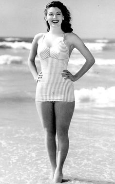 Ava, at the beach! In a one piece! Do they still make those? If not they should!