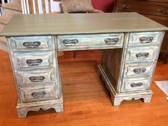 This desk was painted in several different Annie Sloan colors.  Old White, French Linen and Duck Egg.  Finished with clear and dark wax.  The top was sealed with General Finishes High Performance Top Coat in flat.