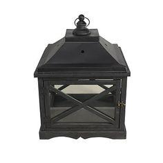 Lantaarn Crossing. Metalen lantaarn met glas, geschikt voor waxinelicht of stompkaars. Zwart, €59.