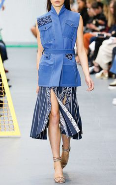 This knit **Peter Pilotto** skirt features a fluted shape with a split panel hem and geometric threadwork embroidery.