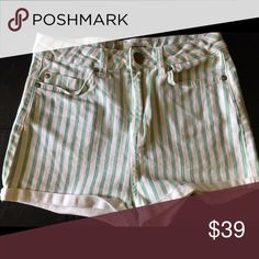 """💙Top Shop Moto high rise stripe short size 8 💙Top Shop Moto high rise stripe short in size 8 inseam 2"""" and rise 11"""". Leg width opening is 11"""" across. Measurements are approximate. Short is striped with mint green and white stripes. Material content consists of 98% Cotton and 2% Elastane. Normal user wear and fade. No tears holes or stains. Overall in very good used condition. Super cute high rise short from Top Shop! 170316ss1 Topshop Shorts Jean Shorts"""