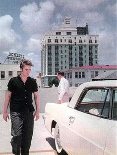 Elvis 21 is outside looking over a new 'Lincoln Continental' in Miami,Florida on Aug 4th,1956 that he decides to buy