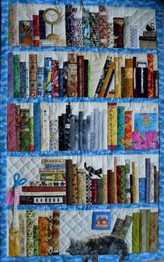 the books are done in strips, You can see the seams. the bookshelf is another strip. Triangles are used in a couple of spots...for lopsided books. Take a photograph of a cat and print it out on material. Applique the scissors.
