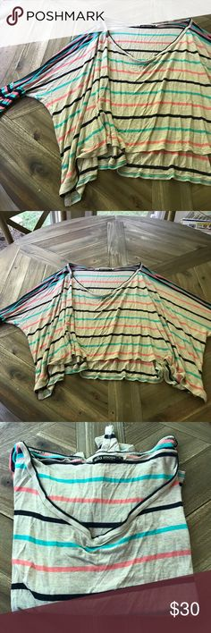 Ella Moss Poncho like top Super cute Ella Moss Poncho like crop top! Fitted sleeve but open and cropped body! Great for summer and cute with cut offs! Previously owned but good condition! Ella Moss Tops Crop Tops