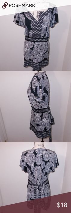 """Plus Size 22W Lane Bryant floral tie wrap blouse Lane Bryant black and white floral print flutter sleeve notched neck blouse with tie belt at waist. machine washable. 100% polyester.   Plus Size 22W - 27"""" pit to pit, 25"""" length  See photos for details. Smoke free, pet friendly home.   Please message me with any questions. Ask if additional size detail is needed.   15% discount for 3+ item bundles. Check out my closet. Happy Poshing!  590/O Lane Bryant Tops Blouses"""