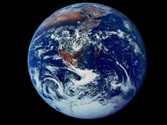 """This famous """"Blue Marble"""" shot represents the first photograph in which Earth is in full view. The picture was taken on December 7, 1972, as the Apollo 17 crew left Earth's orbit for the moon. With the sun at their backs, the crew had a perfectly lit view of the blue planet."""