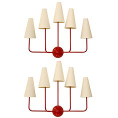 Jean Royere Style Sconces   Pair of Jean Royere style, 5-light, red painted bronze wall sconces w/parchment paper shades   HEIGHT:26 in. (66 cm); WIDTH:33 in. (84 cm); DEPTH:9 1/2
