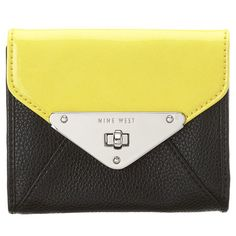 """Bold color block wallets with turn lock closure on front and snap closure on back.  Inside features two full length compartments and 7 card slots.  Measures approx 5"""" L x 4"""" W x 1"""" D."""