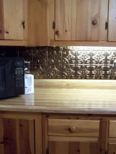 Update kitchen backsplash with the new thermoplastic sheets - easy - fit, cut, and mount with double sided tape.