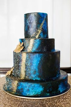 Gorgeous navy blue galaxy wedding cake with gold pearls and starry details