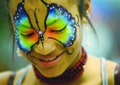 ROBIN LOZNAK/The News-Review  Geniva Johnson ,14, sports a colorful face painting while selling food from a cart at the 33rd annual Spring Fair at the Douglas County Fairground on Saturday.  The fair continues today from 11 a.m. to 5 p.m. Butterfly Face Paint, Spring Fair, Douglas County, Cool Designs, Halloween Face Makeup, Painted Faces, Paint Ideas, Robin, Cart