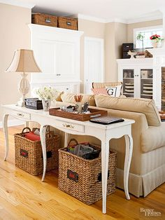Console table with open baskets for storage below