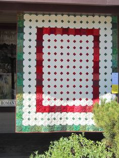 White snowballs on a red and green quilt spotted at the Sisters Outdoor Quilt Show 2011.  Posted by Rebel at home & abroad