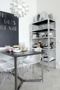 dining area - steel metal industrial shelf - chalkboard wall - Eames chairs - black and white Black Eames Chair, Eames Chairs, Dining Chairs, Dining Area, Kitchen Dining, Kitchen Decor, Kitchen Shelves, Chalkboard Wall Bedroom, White Interior Design