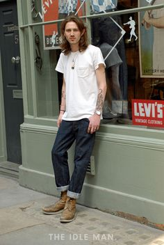 Men's street style | Tattoos & Jeans - Get this chilled look with baggy, cuffed jeans, white T-shirt and tan boots. | Shop the look at The Idle Man