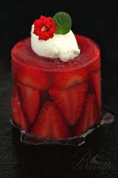Strawberry aspic. Aspics differ from other recipes using gelatin in that the aspic jelly covers the ingredients.