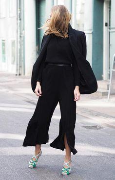 Black sweater + slit-front trousers + draped blazer