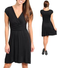 Classy and perfect for the fall! Holiday gatherings? Get this dress and it will be able to be worn again and again for many occasions!  Fabric Content: 95% RAYON 5% SPANDEX   ALL SALES ARE FINAL!