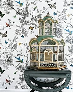 Gorgeous bird cage (with more birds on the wallpaper). This photo was originally from Martha Stewart, but seems to be no longer on that website.