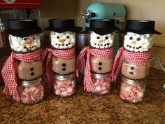 Snowman made from baby food jars. The top jar is filled with marshmallows. The middle jar is filled with hot chocolate mix. The bottom jar is filled with mints. Cute idea for Xmas gifts
