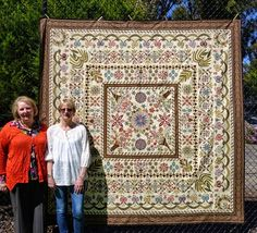 Esther Aliu (designer) and Narelle Birchall (quilter and appliqué artist), both from Australia, with Narelle's Love Entwined quilt.