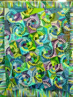 """Although this quilt isn't Quiltworx, it is a Quilt that Judy and Bradley helped design!  Dreamcatchers...A New Beginning by Wayne Sneath.    This pattern is called """"Montana Cartwheel"""". Offset New York Beauties again. New York Beauties is one of my favorite blocks of all time!"""