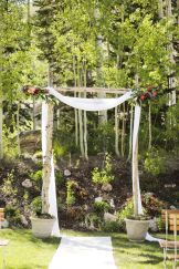 Simple arbor with white fabric & floral bouquets in each upper corner || Floral, Decor and Planning by Harvest Moon Events | Photo by Logan Walker