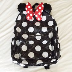 Authentic Disneyland Minnie Mouse Sequin Backpack • Authentic Minnie Mouse Backpack purchased from Disneyland. • Sequins all over, except ears and bow. • Standard backpack size, equivalent to a standard Jansport backpack. Disney Bags Backpacks
