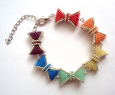 Rainbow Bows Bracelet  beadwork  beading by craftinghard on Etsy