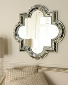Quatrefoil Mirror at Horchow.  I've never wanted to marry a mirror before.  Until now.