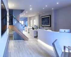 Janey Butler Interiors - Commercial Renovation luxury real estate office with inspiring design and architecture