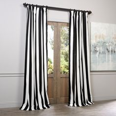 This black-and-white cotton curtain panel will make any decor more contemporary. The striped panel is 120 inches long and features a shade-enhancing cotton lining. The three-inch pole pockets and hook-belt headers make this panel easy to hang.