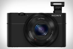 """SONY CYBER-SHOT RX100 CAMERA  A huge part of image quality in digital photography is the size of the sensor capturing the moment. Unfortunately, most point-and-shoots sport measly 1/2.3"""" sensors that don't let in a lot of light, making higher ISO values necessary and thus introducing more noise into your image. The Sony Cyber-shot RX100 Camera ($650) looks to overcome these limitations with a massive 1-inch, 20.2 megapixel Exmor CMOS sensor that promises to deliver images that belie the…"""