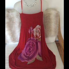 Red sundress nwt knee length with roses Red sundress with thin adjustable strap can be worn with straps or tucked in for clean line.  Right blow the knee is wwer thi hems will fall.  Perfect o warm summer days an. Evenings.  Or the perfect beach coverup. Dresses Midi