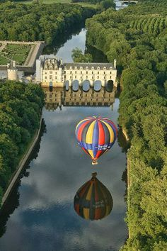 Chenonceau Castle and a ballon reflected on the Cher river, France