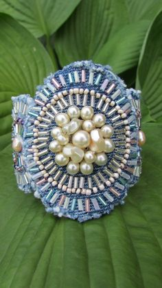 Bracelet Cuff - Pearl Statement Piece -  OOAK Hand Beaded Recycled Denim  with Vintage Faux Pearl Centerpiece. $95.00, via Etsy.