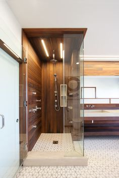 Lighting in the bathroom is provided by San Francisco-based Aion LED's modular fixture system. The linear lighting mimics the redwood siding. Courtesy of: Chris Brigham Mold In Bathroom, Glass Bathroom, Small Bathroom, Master Bathroom, Bathroom Ideas, Concrete Bathroom, Bathroom Showers, Bathtub, Modern Bathroom Design