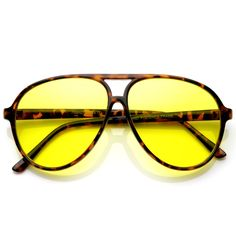 Classic plastic yellow lens sun blocking aviator sunglasses with a tear-drop frame design. The specialized lens increases the difference in sharpness. Yellow Lens Sunglasses, 70s Sunglasses, Mirrored Sunglasses, Sunnies, 1990s Fashion Trends, 80s Fashion, Fashion 2018, Cheap Fashion, Fashion Boots