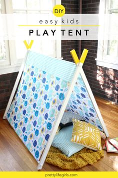 DIY Kids Play Tent Tutorial - The Pretty Life Girls | This DIY kids play tent was surprisingly simple to make (if you can drill 4 holes, you can make it!) and folds up for easy storage. You can use any fabric and paint combo to take it to the next level! This little cutie is just right for cozying up with a stack of books to make the most of summer reading, or for watching movies after dark while there's still no school to get up early for the next day. Diy Projects For Kids, Diy Wood Projects, Diy For Kids, Palette Deco, A Frame Tent, Diy Tent, Kids Tents, Easy Diy Crafts, Kids Crafts