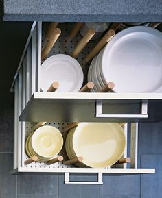 Just because you're focusing on style, doesn't mean functionality should fall by the wayside. These drawers with peg dividers in a sleek kitchen designed by Alexander Adducci keep plates in various sizes super organized — and will impress guests too (trust us).   - HouseBeautiful.com