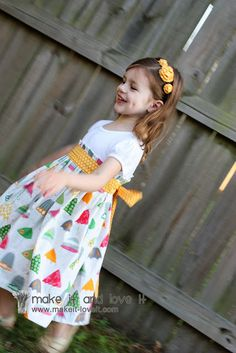 Does your little girl have an old T-shirt? One that is too short? Stained on the belly? Has a rip right through the fabric? No worries……turn it into a sweet pleated dress. With a nice big pleated waist line… And a nice chunky bow to cinch it all in. And yes, this dress is perfect …