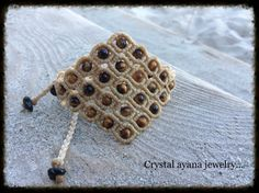 Macrame micro macrame beige rhombus bracelet with tiger eye and black onyx beads...