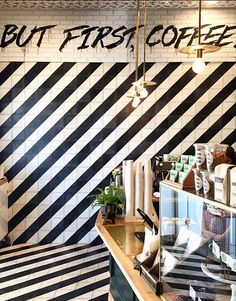 "black and white striped walls with ""but first coffee"" written // alfred coffee & kitchen - some of the best coffee in L.A. #vacation #travel"