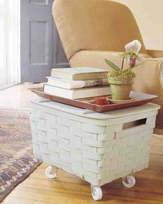 This movable end table hides clutter and can be wheeled off to wherever it's needed or stored away when it's not.