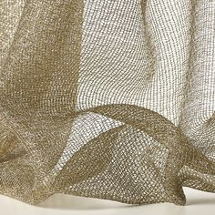 LUX col. 001 by Dedar - The use of fine lurex thread combined with both the weft and weave yarns to create an effect of pure luminosity.