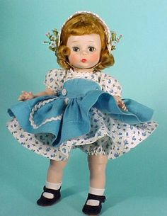 1950's Alexander-kins on  Blue pinafore/apron over blue and white floral dress