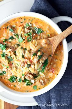 Sausage Orzo and Spinach Soup Recipe -- Italian sausage, orzo pasta and fresh spinach combine in a creamy tomato based broth in this creamy, hearty soup that's both easy and delicious. #soup #orzo #recipes