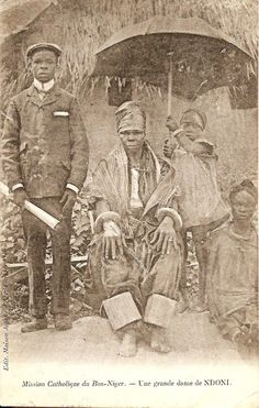 A titled Igbo woman, Ndoni, Igboland [present day northern Rivers State, Nigeria]. Postcard from the turn of the 20th century.