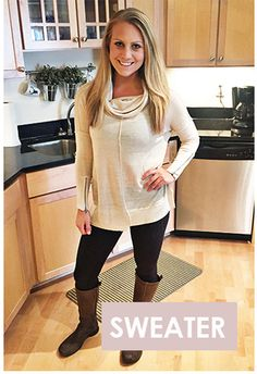 I like this sweater - I love a cowl neck, but maybe in another color. Love the zipper detail.